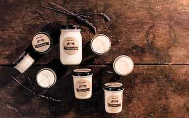 Modern Forestry Soy Candles Group Shot On Distressed Rustic Wood Table
